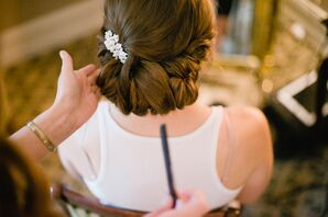 Elegant Bridal Updo with White Hair Accessory