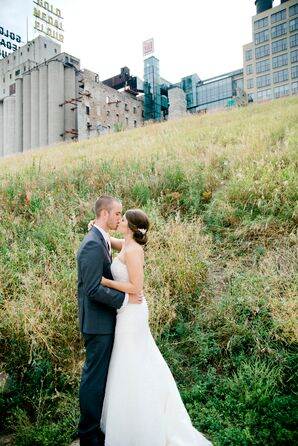 Bride and Groom Against City Backdrop