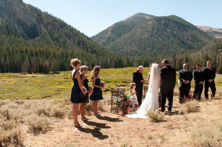 """Juli and Mike exchanged vows at Bridger-Teton National Forest in the Wyoming mountains. """"We live in Big Piney, Wyoming,"""" Juli says. """"The mountains are where we both feel most at home. There was a large wildfire that summer, but the spot we had chose was one of the only places that hadn't burned. It was absolutely beautiful."""""""
