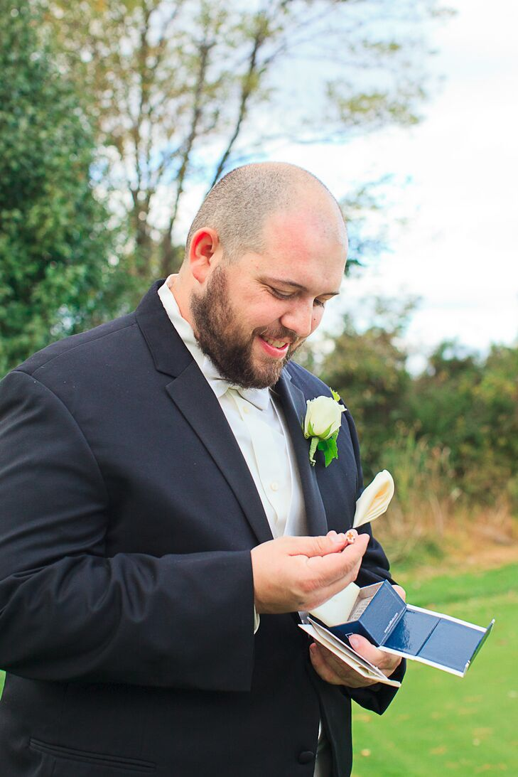 Randy wore a classic black tuxedo with a white bow tie and white rose boutonniere. As the groom is a car lover and owns a vintage Chevrolet Camaro, Sophia gifted her groom with a pair of Chevrolet logo cufflinks. She later surprised him with a Camaro groom's cake modeled after his own car.