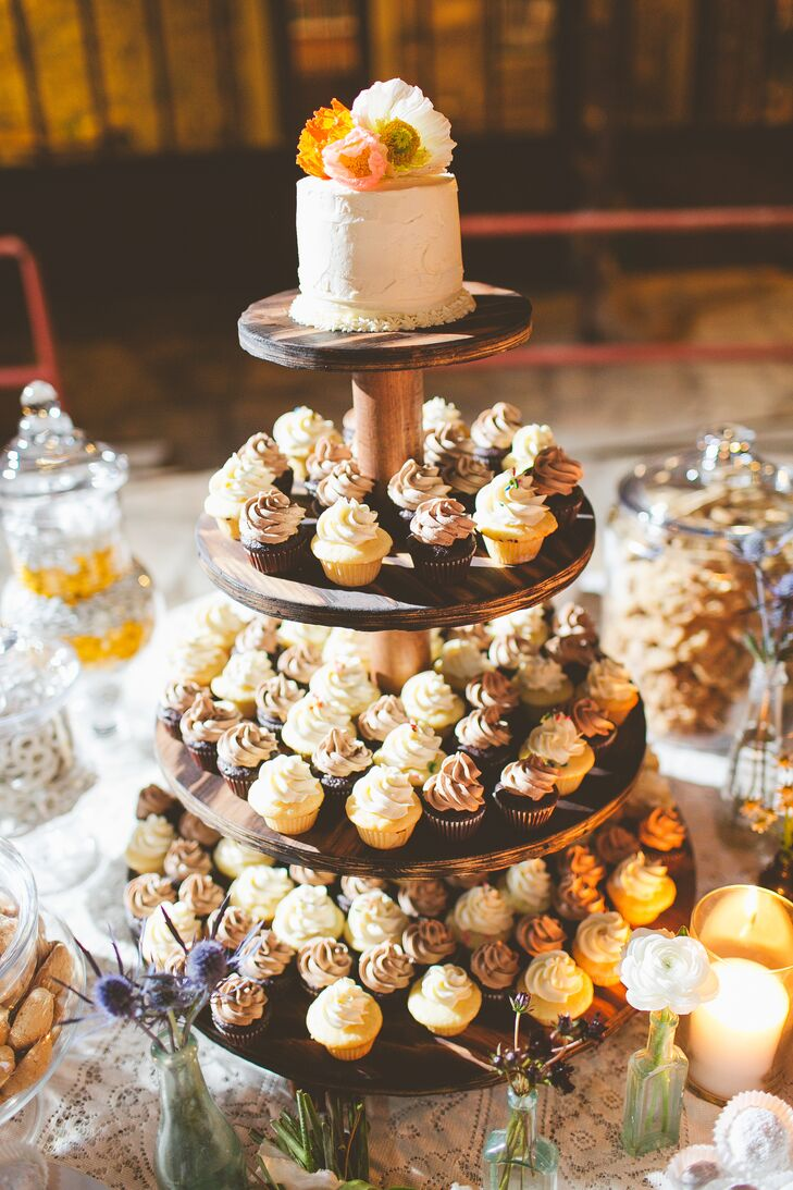 The dessert buffet was totally DIY, from the cupcake stand Taylor crafted from the homemade sweets. A single-tier wedding cake topped tiers of miniature cupcakes, surrounded by a variety of cookies and candied pecans (it was a Texas wedding, after all).