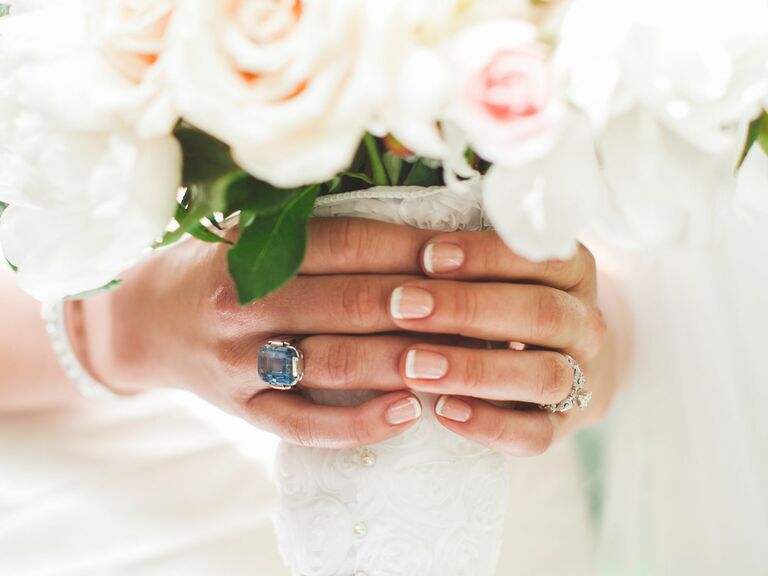 7585158e92 Bride with French tip nails holding a bridal bouquet - Bridal Nails