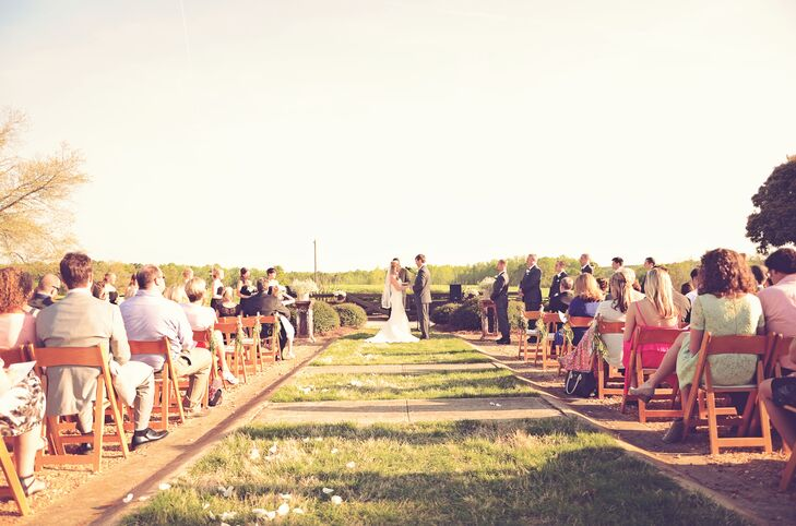 "The ceremony took place in a courtyard between two of the three brick barns. ""We were overlooking the rolling green pastures, beautiful fence lines and open blue sky,"" says Adrienne. ""The view was amazing and made us feel like we were able to truly embrace being there with just 'us' and our closest family and friends."""