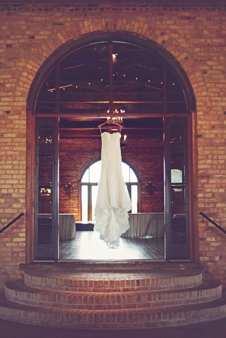 "What really sold Adrienne and Lucas on their venue was the beautiful brick barns with exposed wood beams and massive wrought iron chandeliers, rolling pastures and skyline.  ""The venue speaks for itself and really doesn't require much decor,"" says Adrienne."