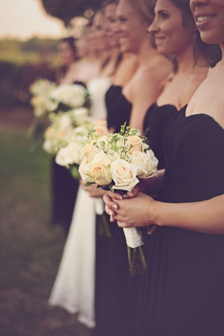 The bridesmaids carried white rose bouquets ordered from Sam's Club rearranged to include addition blush blooms.