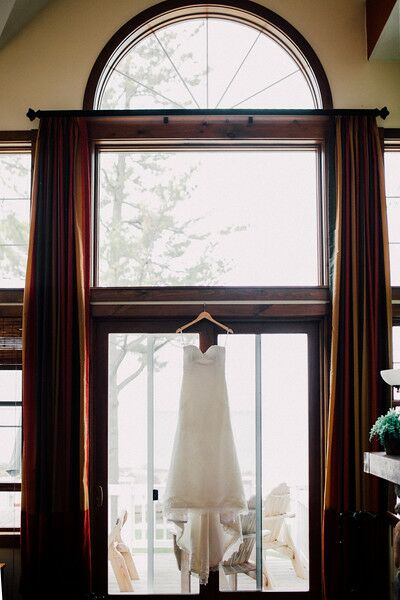 "Kelsey describes her wedding day look as simple, timeless and comfortable. When shopping for wedding gowns, she tried on the Evelyn gown by Anais Anetter, a lace fit-and-flare, ""just for fun."" As soon as she had it on, knew it was her dress."