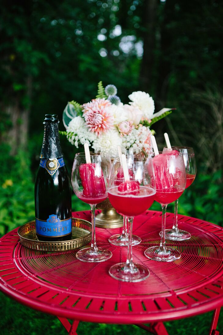 Bright red champagne popsicles were served to guests.
