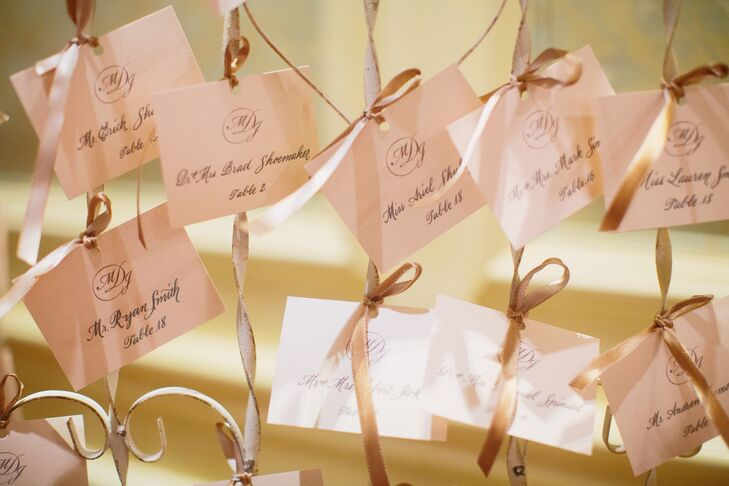 Each of Megan and Josh's 162 guests found their escort card hanging from champagne ribbon.