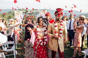 Couple Recessing at Hindu Ceremony as Guests Toss Petals