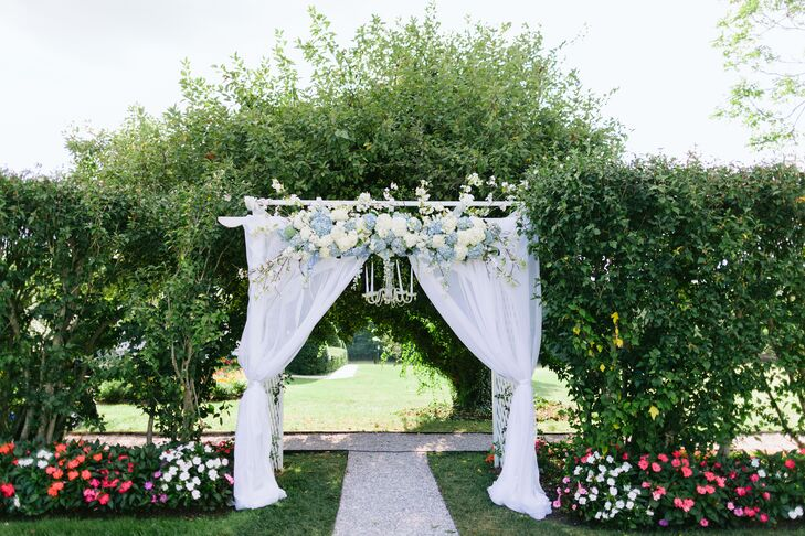 Dreamy Wedding Arch With Blue And White Flowers