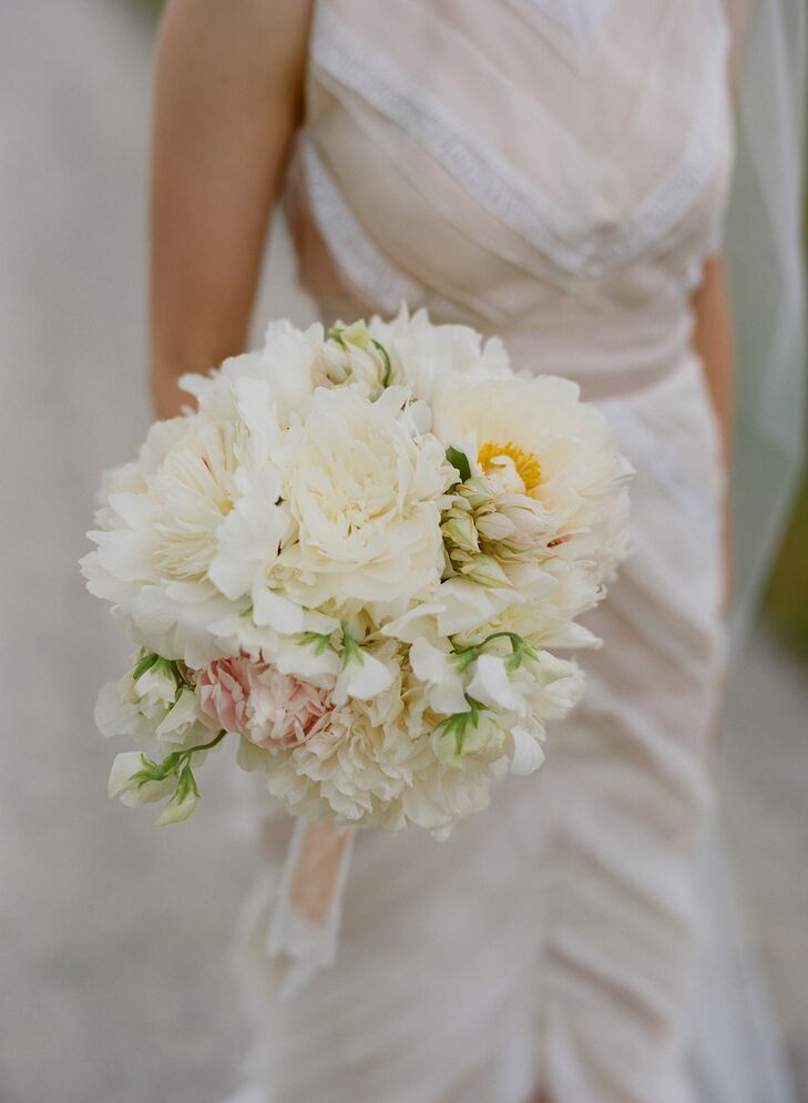 Chutney's bouquet echoed the softness of her J. Mendel dress. The round blooms included only ivory and blush peonies and sweet peas.