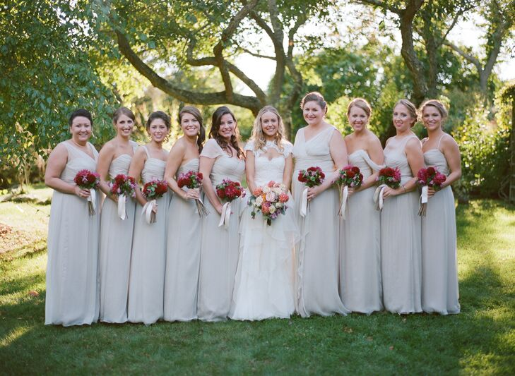 """To create a cohesive look, while still allowing her bridesmaids to show off a little of their personalities, Michelle had them choose their own dress styles from Amsale's bridesmaid line. """"I opted for a neutral color because the flowers were so bold,"""" Michelle says. """"I really wanted them to pop against the bridesmaid dresses."""""""