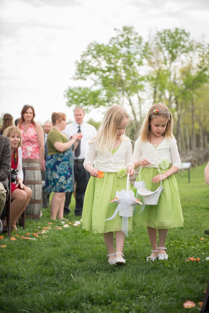 The flower girls, Travis' daughters, wore playful lime green dresses with white cardigans at the vineyard ceremony.
