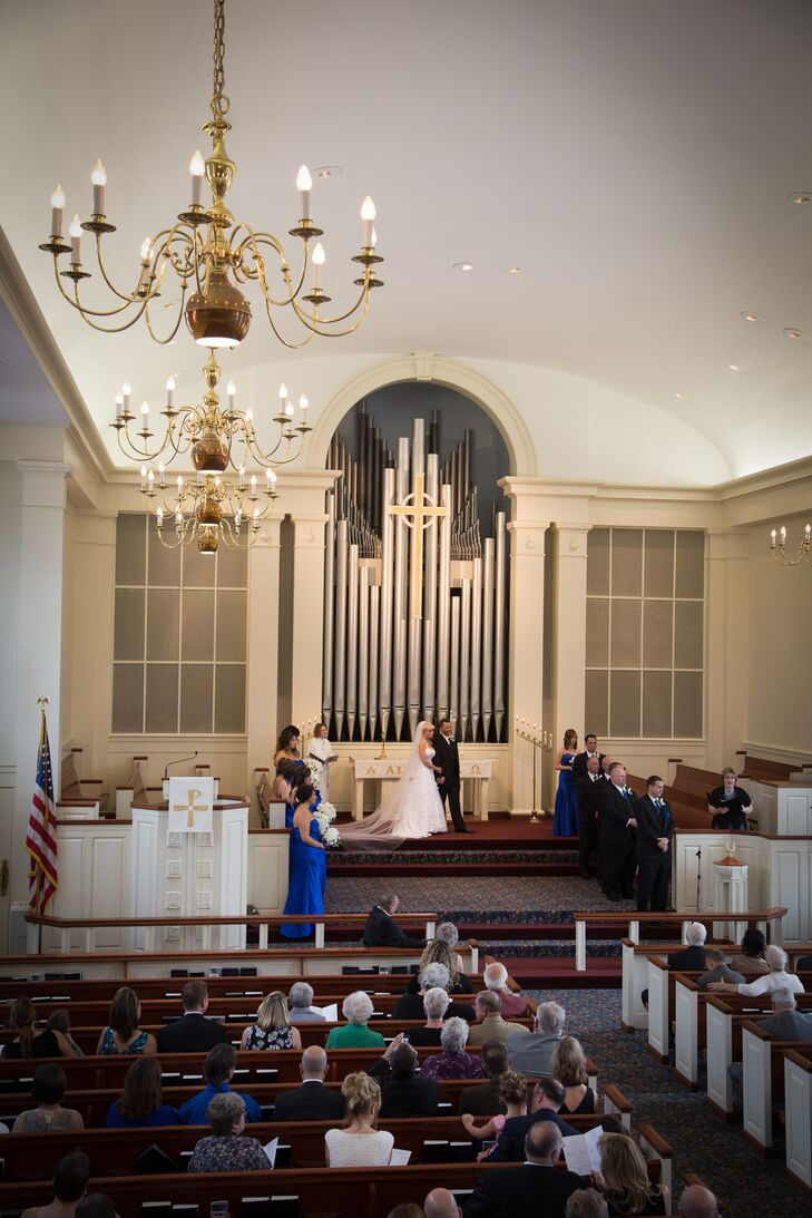 """The beautiful and unique pipe organ was a central focal point,"" says the couple. ""The church also has amazing large stained glass windows, a long isle, and an elegant entranceway with double doors."""
