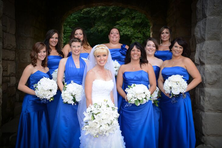 """Bridesmaids selected their own dress style of dress, with the only direction being that it had to be royal blue and long,"" says Genell. ""Almost all choose strapless with a flowing bottom in satin."""