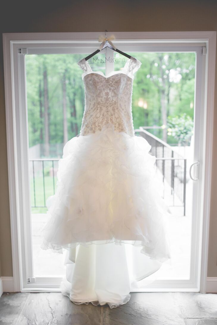 It took Mandy nearly a year to design her custom Kenneth Winston wedding dress. The dress featured a fitted lace bodice, cap sleeves and a ball-gown style.