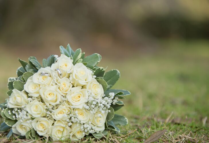 Heather carried a traditional ivory bouquet down the aisle, filled with roses, baby's breath and variegated greenery.