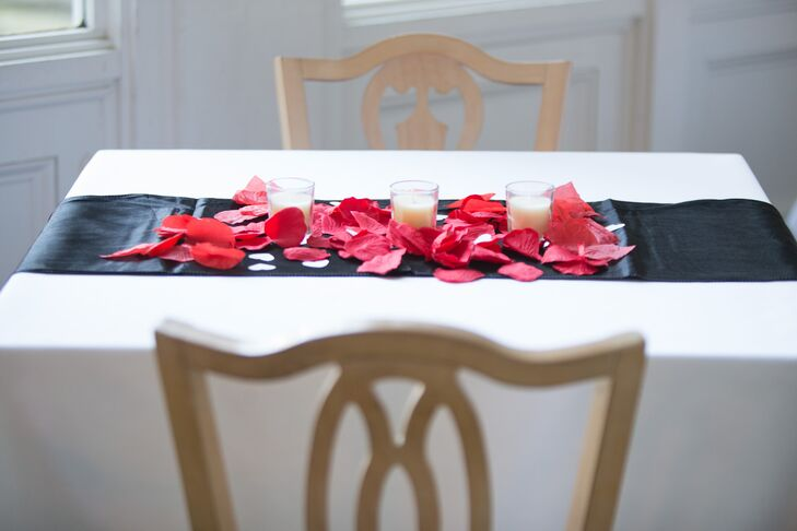 To create a romantic, ambient atmosphere, Heather and Dameon decorated the reception tables with red and pink rose petal, plus plenty of candles.
