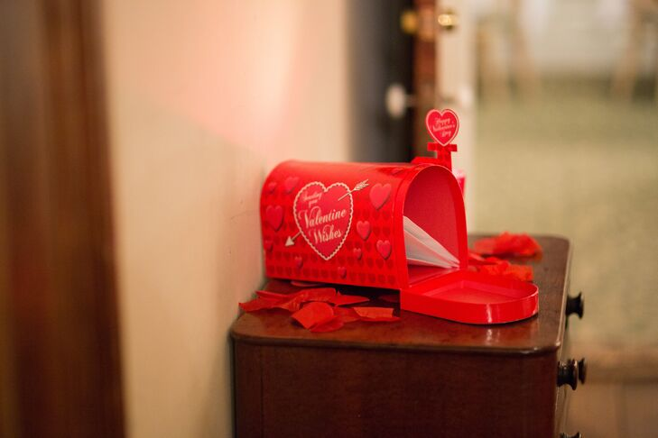 Keeping with the Valentine's Day theme, the couple displayed a bright red, heart-accented mail box for family and friends to place their cards.