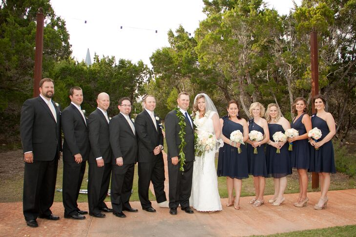 The bridesmaids wore navy blue dresses from Ann Taylor. The groomsmen wore dark gray suits with cream blush pocket squares. The groomsmen ties were cream, and the groom wore a darker blue tie.