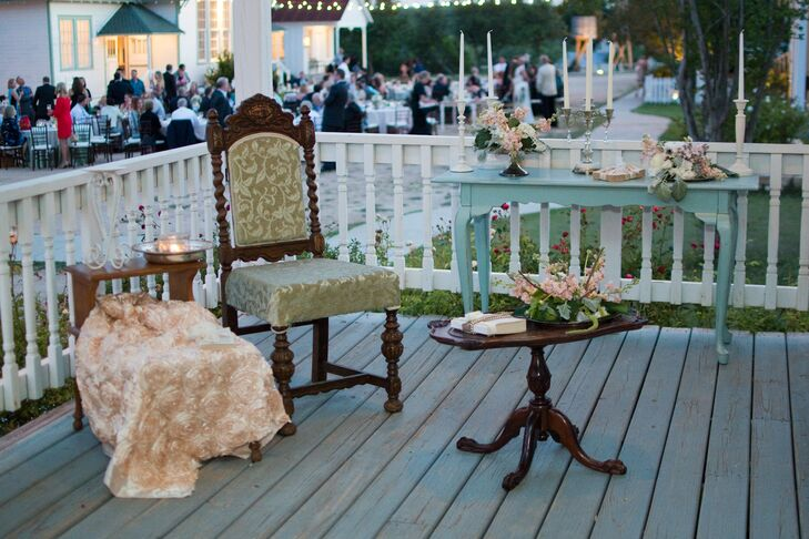 Cocktail hour was set up on several porches with vintage furniture and chiffon white curtains billowing in the breeze to add a touch of Southern charm. The couple found several Victorian love seats to create a lounge on the front porch of one of the buildings by the reception.