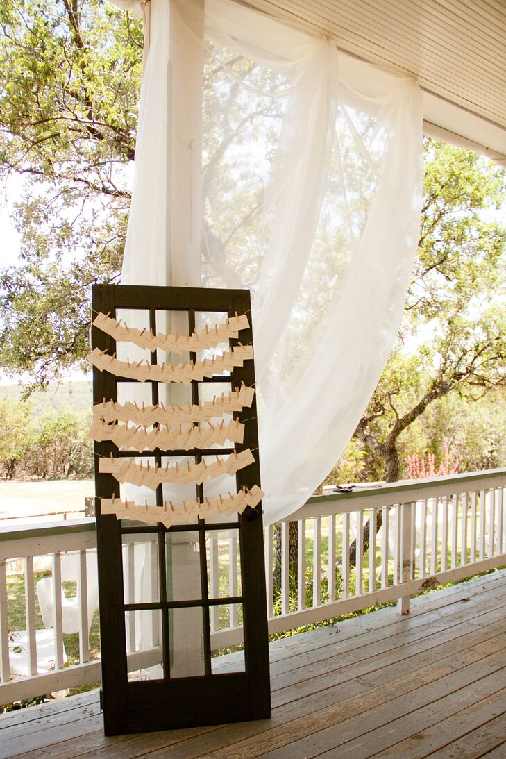 The couple utilized an old door to display the escort cards.