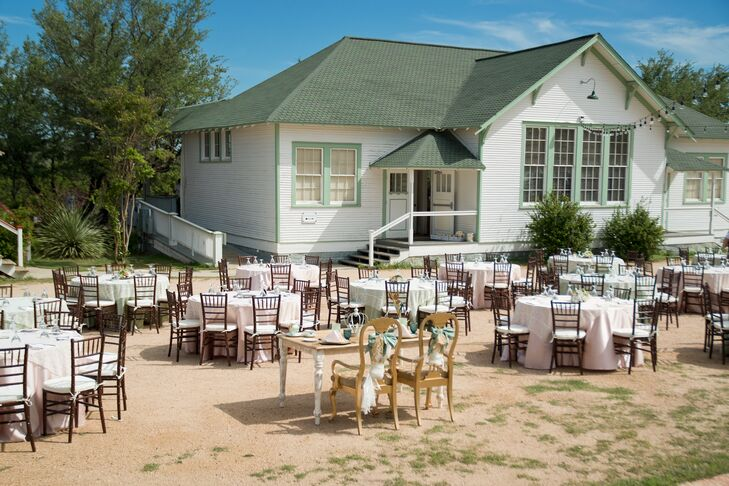 """The couple chose to be married at Star Hill Ranch just outside of Austin, Texas in the Hill Country. """"The little 'town' there was the perfect setting to match the vintage feel of the wedding decor,"""" says the bride."""
