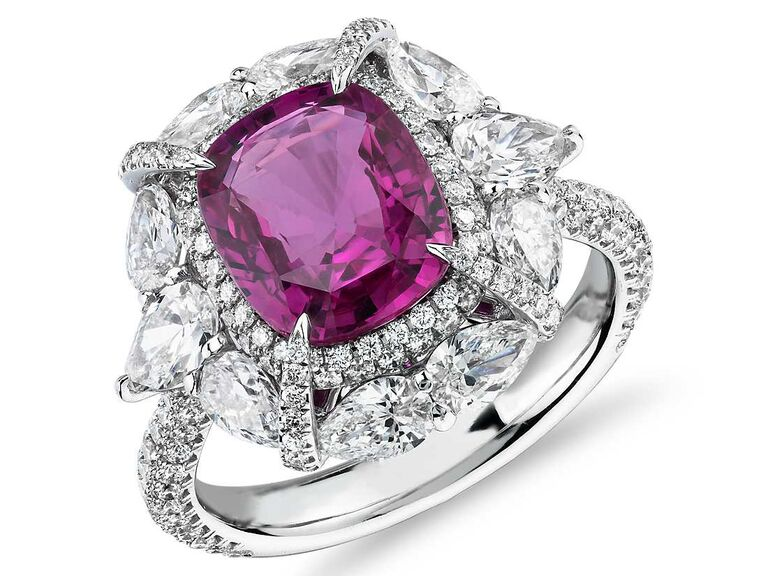 PInk sapphire engagement ring with pear-shaped diamond halo