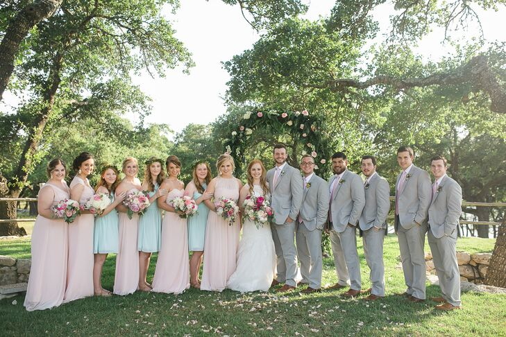 The groomsmen wore gray Jos. A. Bank suits with petal-pink paisley ties, matching the pink bridesmaid dresses. The junior bridesmaids wore light blue tea-length dresses.