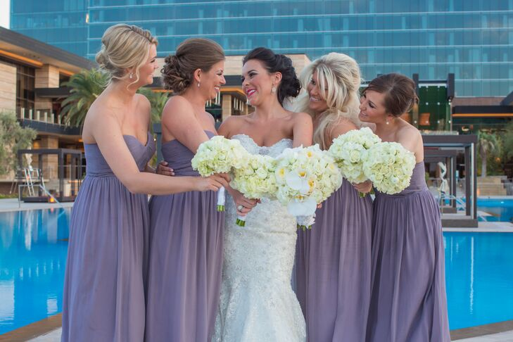 5fb566ccff4c Kelle's bridesmaids wore soft purple floor length silk gowns purchased  through Nordstrom's evening wear. Their