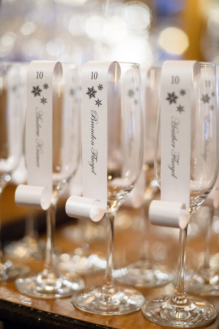 Erica and Janson wasted no time getting the party started after the ceremony, welcoming guests to the reception with a glass of champagne. Attached to each champagne flute was an elegant snowflake-studded scroll—personalized with each guest's name—that directed guests to their seats.