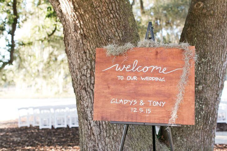 Gladys's sister, also the maid of honor, hand-painted signs on rustic wooden planks leading guests toward the ceremony area.