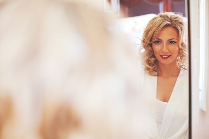 The brides wore her hair down in soft curls for the big day.