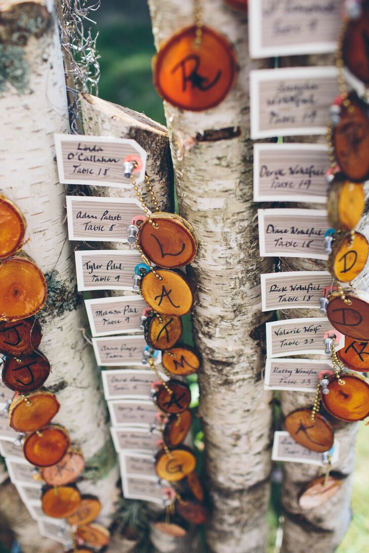 Birch trees held the wood slice escort cards, made by Brin's father.