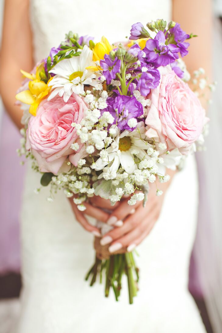 The bride carried a pastel bouquet filled with hydrangea, lavender stock, garden roses, white daisies and yellow freesia.