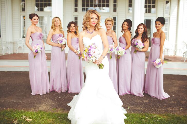 The brides wore ethereal, lavender-colored dresses complete with an empire waist.