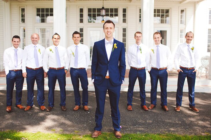 """Each of the groomsmen wore blue suit pants, a brown belt and brown shoes. """"I wanted to keep it natural and easy, so I skipped on the jacket and tuxes all together,"""" the bride explains."""