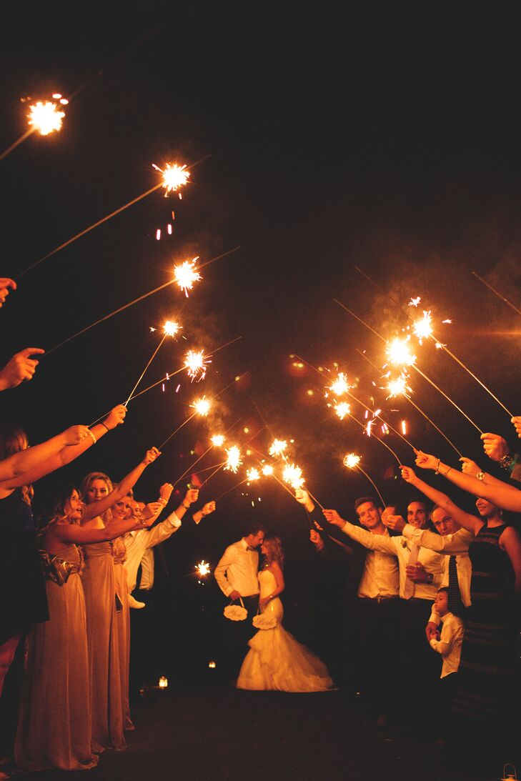Wedding guests sent the couple off with a sparkler exit that signaled the end of the night.
