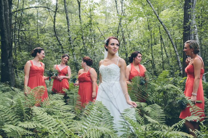 The bridesmaids wore salmon red dresses with different necklines.