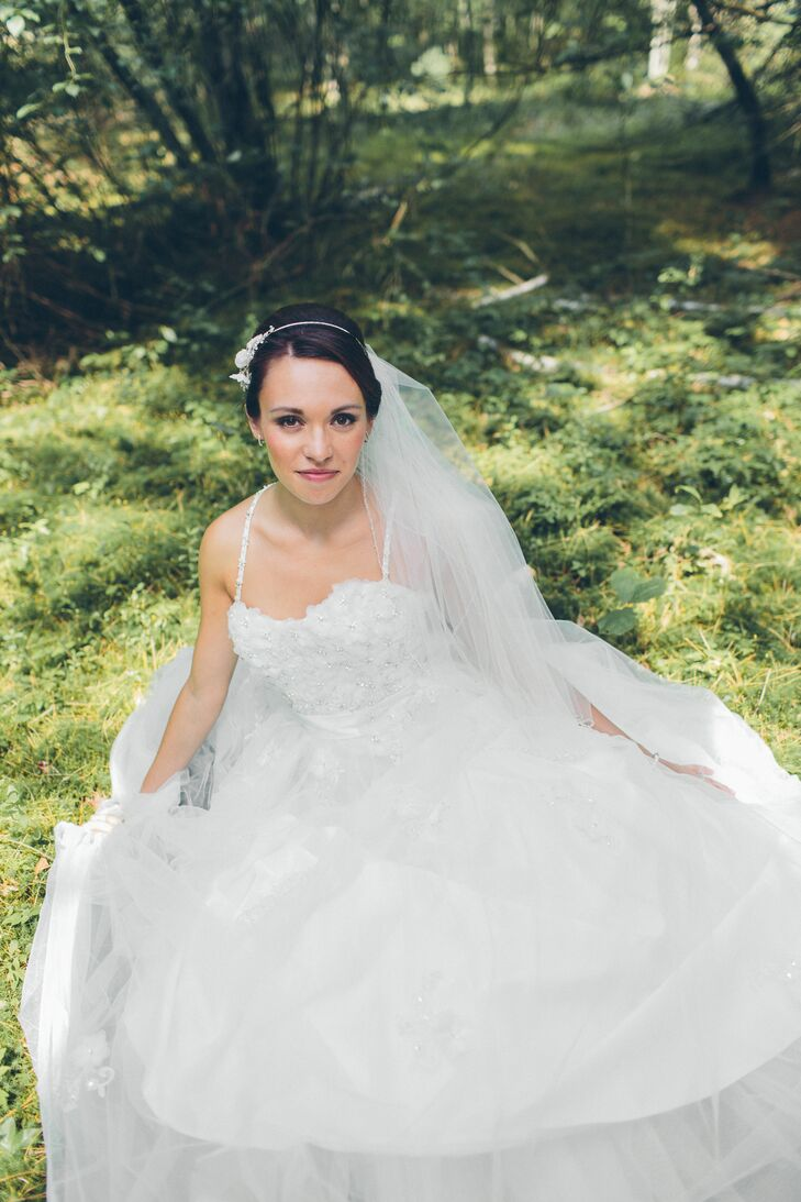 """Brin chose her gown from Alfred Angelo's Disney collection. The """"Snow White"""" dress had cherry blossoms covering the bodice and a tulle skirt."""