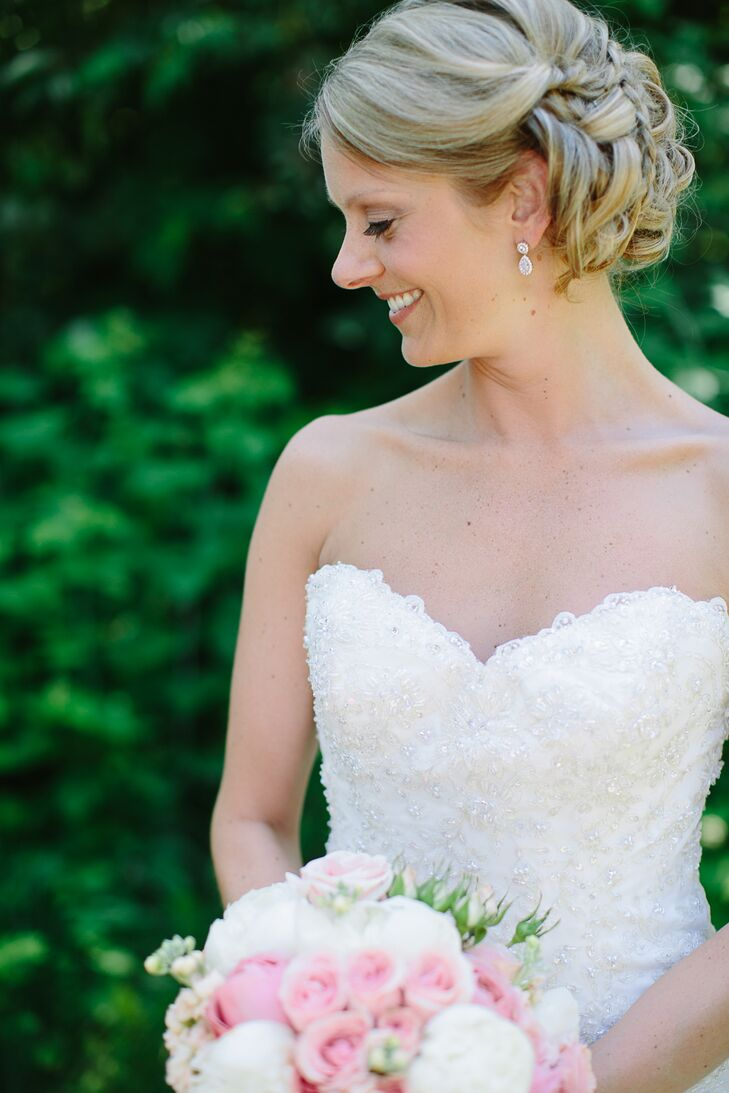 Kelsey wore a James Clifford wedding dress down the aisle. The embroidered, ball-gown shape was her instant favorite. Kelsey's minimal jewelry complemented the sweetheart neckline.