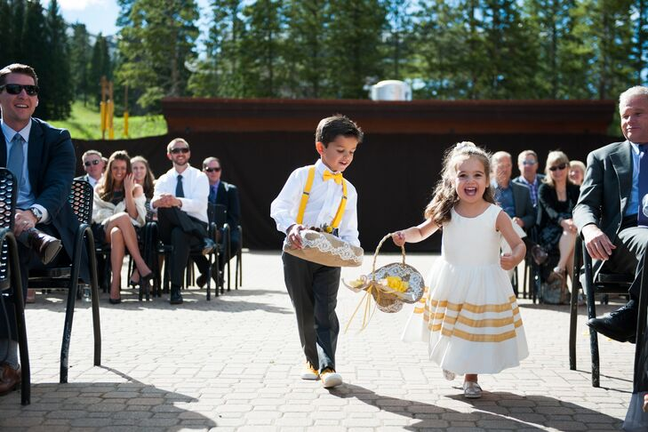 The flower girl wore a white dress with gold stripes to match the pattern of the bridesmaid dresses. The ring bearer wore yellow suspenders and a bow tie to match.