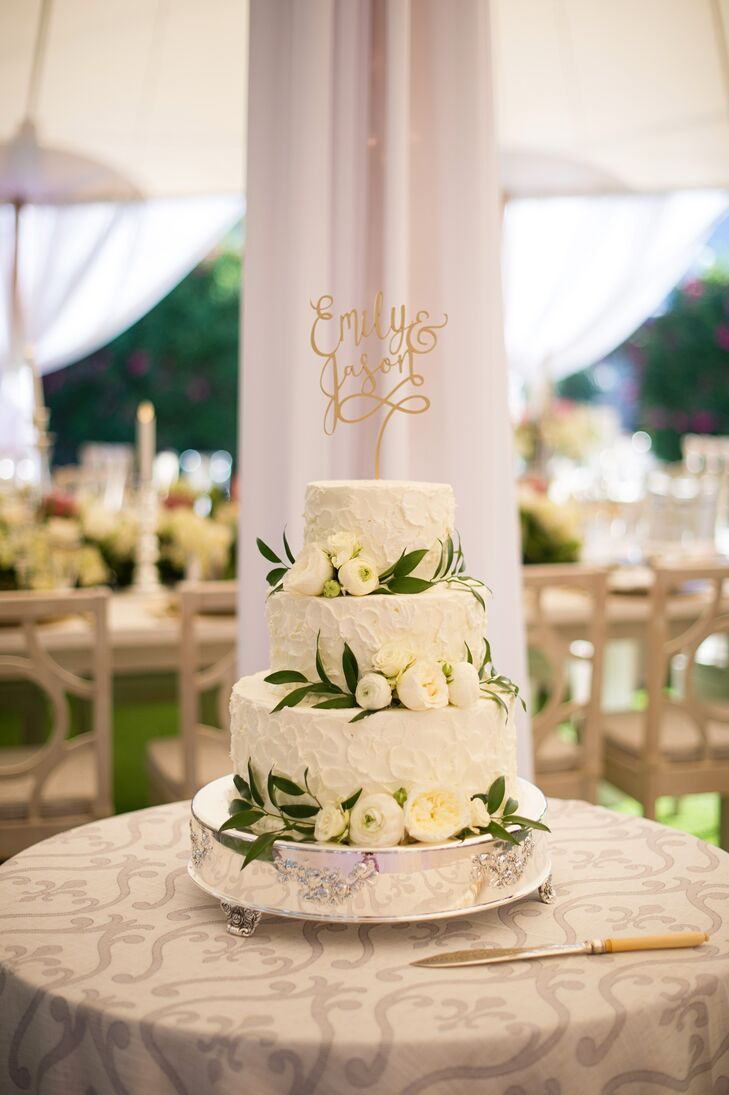 The Tipsy Cake Company in Boca Grande, Florida, whipped up a decadent three-tier carrot cake with cream cheese frosting for Emily and Jason's after-dinner treat. Clusters of ivory garden roses and ranunculus framed by vines and a personalized gold script cake topper decorated the cake, striking the perfect balance of whimsy and Provencal elegance.