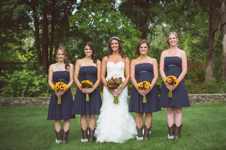 """Cheryl's four bridesmaids wore navy, strapless dresses purchased at Arena Bridal in Shelby Charter Township. """"I wanted my bridesmaids to wear cowboy boots with me, that's why I chose the shorter dress,"""" Cheryl says."""