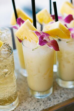 Pina Colada Drinks with Flower and Pineapple Garnishes