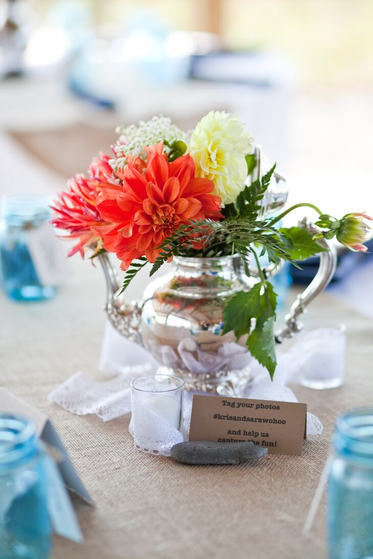 Sara and Kris found silver teapots at thrift shops and polished them for dining table centerpieces. They filled the antique pieces with colorful chrysanthemums, roses and a mix of other blooms.