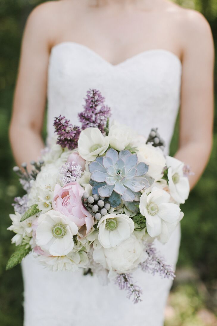 "As a working lavender farm, Marianmade Farm is no stranger to florals. Michelle Peele put her expertise to work, creating beautiful arrangements of local, seasonal blooms in soft shades of pink, ivory, purple, silvery gray and blue. ""Given our theme and palette, Michelle suggested using wooden trays and sea glass bottles to display the flowers,"" Emily says."