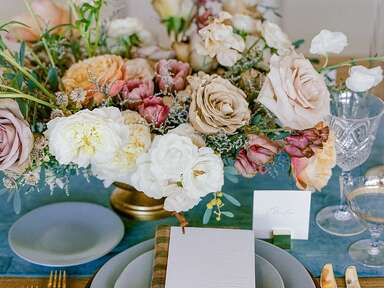 Rustic place setting with colorful rose centerpiece