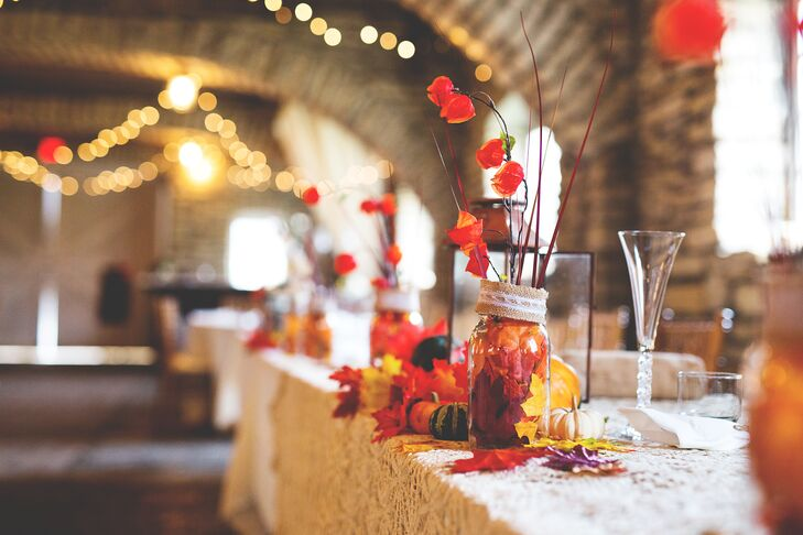 The tablescape decor was reminiscent of a fall harvest, with rich leaves, mason jars and seasonal flowers.