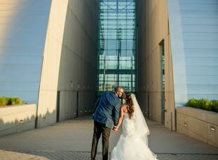 "The threat of torrential rain wasn't enough to prevent Krishelle Ricketts and Brandon Ivory from saying ""I do"" in a rooftop ceremony high above Kansas"